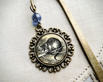 Alice in Wonderland Cheshire Cat brass book hook bookmark with dangling glass cabochon accent
