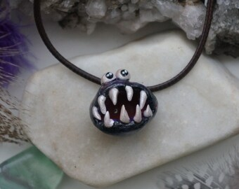 Polymer clay Langoliers Pendant Necklace.