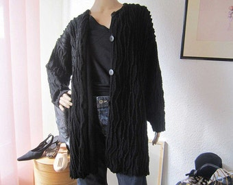 Vintage knit cardigan sweater with oversize structure