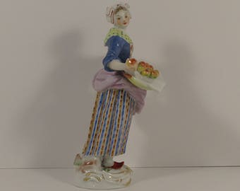 "Meissen Porcelain Figure ""The Apple Seller."" Model Number 17, ca. 1967"