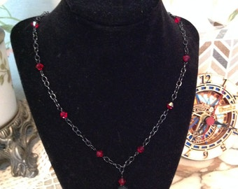 Chain necklace with red Swarovski crystals and black pave ball