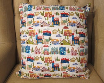 Multi-coloured Christmas village scene cushion cover with pad
