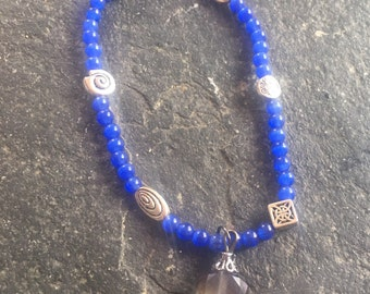 Indigo glass beaded stretchy bracelet with charm