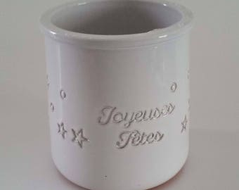 "White yoghurt cup with ""Joyeuses Fêtes"""