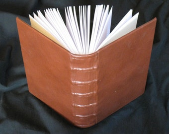 Large brown-red lined journal