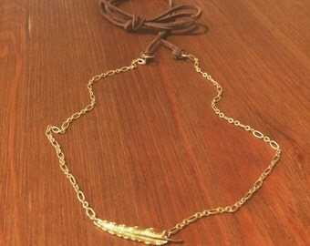 Gold feather and leather tie necklace