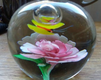 Vintage art glass paperweight with flower and butterfly