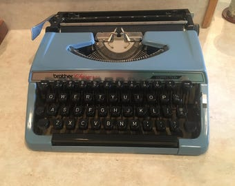 Vintage Brother Charger 11 portable typewriter blue w/black cover