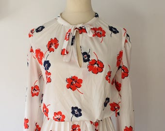Vintage white dress with flowers red and blue was spring, pleated