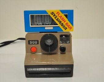 Polaroid 500 for SX-70 film + Sylvania Flash