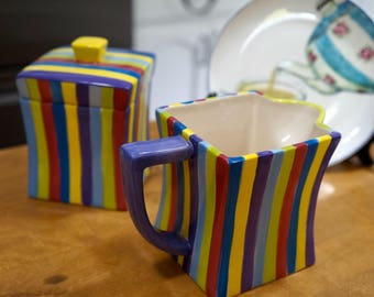 PACIFIC RIM Sugar Bowl and Creamer in Fiesta Pattern Colourful Stripes and 4 Dessert Plates in Tea Motif (still in box) by London Drugs