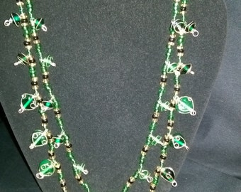 Gorgeous double strand glass beads necklace with gold and black.