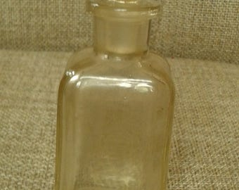 Vintage glass jar with glass stopper.