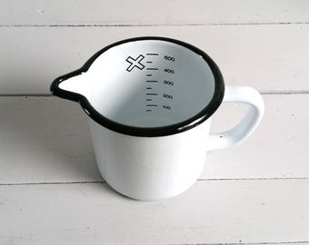 Old white enamel measuring cup