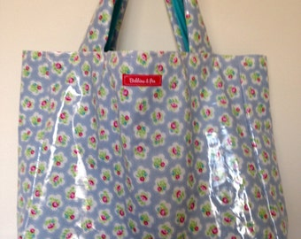 Ditsy flower lined oilcloth bag