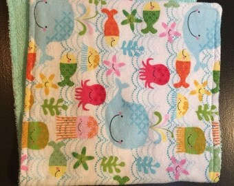 "Burp cloth, flannel and terry cloth. Generous size, 10"" x 20"""