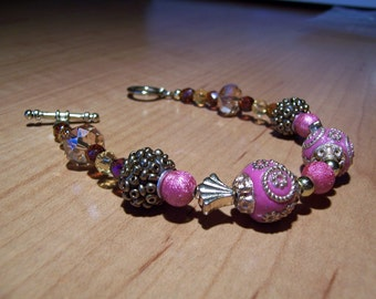 Pink, Gold, and Bronze Womens Bead Bracelet