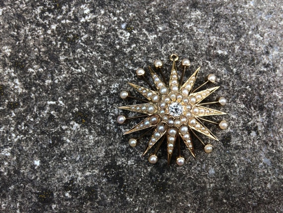 Victorian 12 ray star pendant with 0.4 ct old-cut diamond and split pearls.
