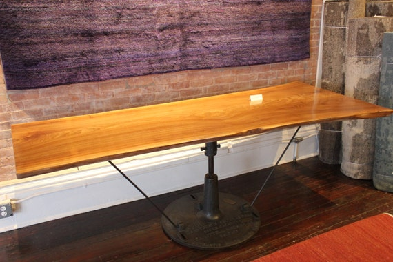 live edge single slab dining table with one of a kind antique industrial base