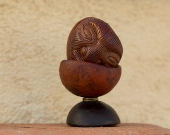 Ni Hiding face Avocadostone sculpture