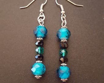 Turquoise beaded dangle earrings with silver detail