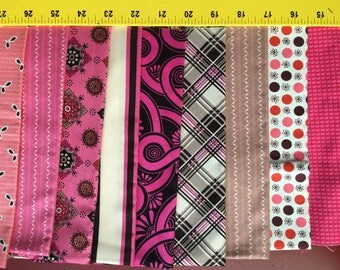Quilting Cotton Denyse Schmidt 9 assorted fat quarters.  Pinks and Browns.  Mostly Anosonia.