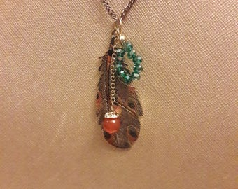 Copper chain necklace with feather pendant