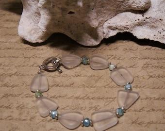 Clear Beach glass bracelet, with aqua blue czech glass beads