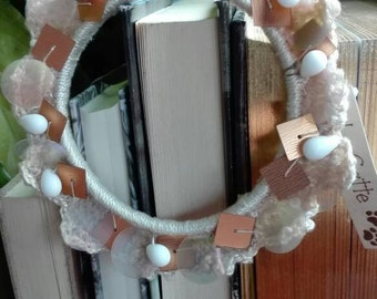 Coated cotton crochet Bangle, pearls and laminated applications.