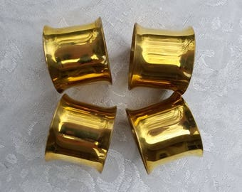 Set of 4 vintage solid brass napkin rings