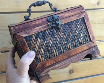 Vintage wooden storage box with embossed rattan design and burnished brass handle. Pirate style chest with decorative handle and clasp.