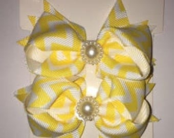 Yellow Chevron shoe bows that come with a magnetic snap to attach to SASSAFLATS shoes they can also be worn in the hair
