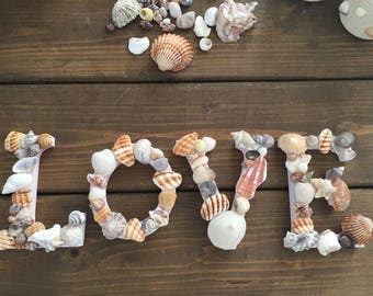 Wooden seashell letter