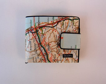 Wallet with geographical Atlas