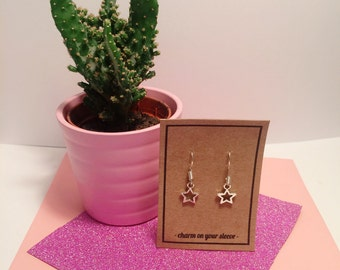 Silver plated star dangle earrings