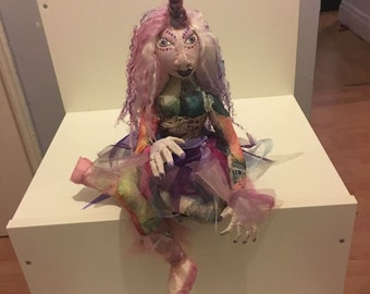 Unicorn  soft sculpture art cloth doll, with pink and purple hair and a shimmering horn