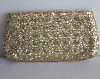 Sale:         A Gold spangled clutch cosmetic bag.