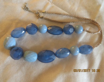 Bold blue necklace on rope