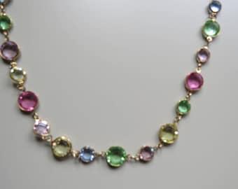 Sweet versatile vintage necklace.  Glass discs in various pretty colours.