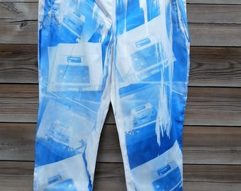 Re vamped cropped stretched trousers with camper vans printed on them blue.