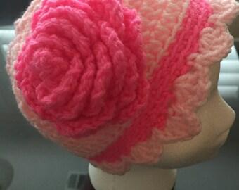 Child crochet hat.  Light pink with dark pink flower.