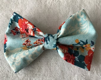 Light blue bow with multicolored floral print