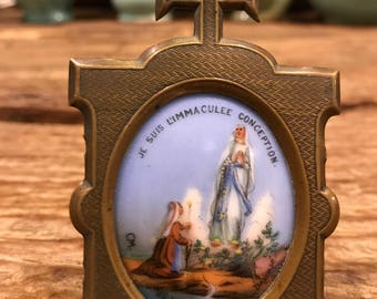 Antique French religious hand painted porcelain Our Lady of Lourdes in a brass frame dated 1858 and signed CM