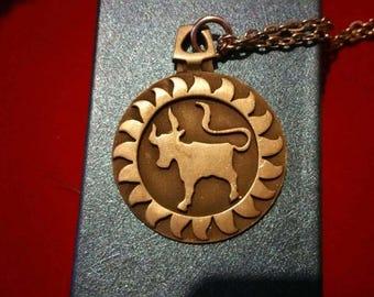 1970s horoscope Taurus ,bull in pewter pendent signed R.tennesmed from Sweden.