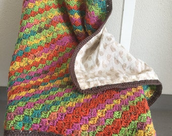 Brightly colored crocheted baby blanket