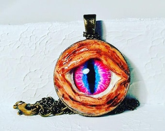 Hand sculpted eye pendents