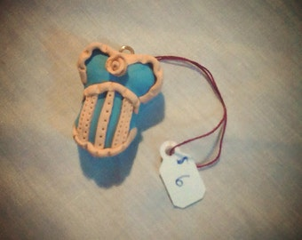 Corset pendant. Turquoise and peach