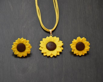 Yellow sunflower pendant with studs.