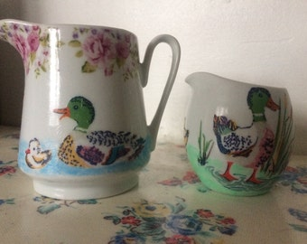Ceramic hand painted and decoupaged Cath Kidston set of 2 jugs