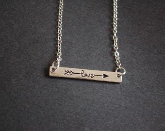 Silver tone love arrow necklace